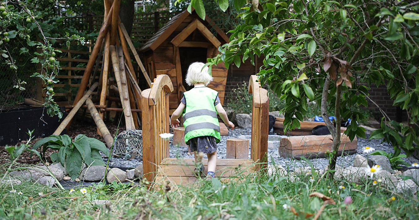 small child at minihome nursery in their nature garden